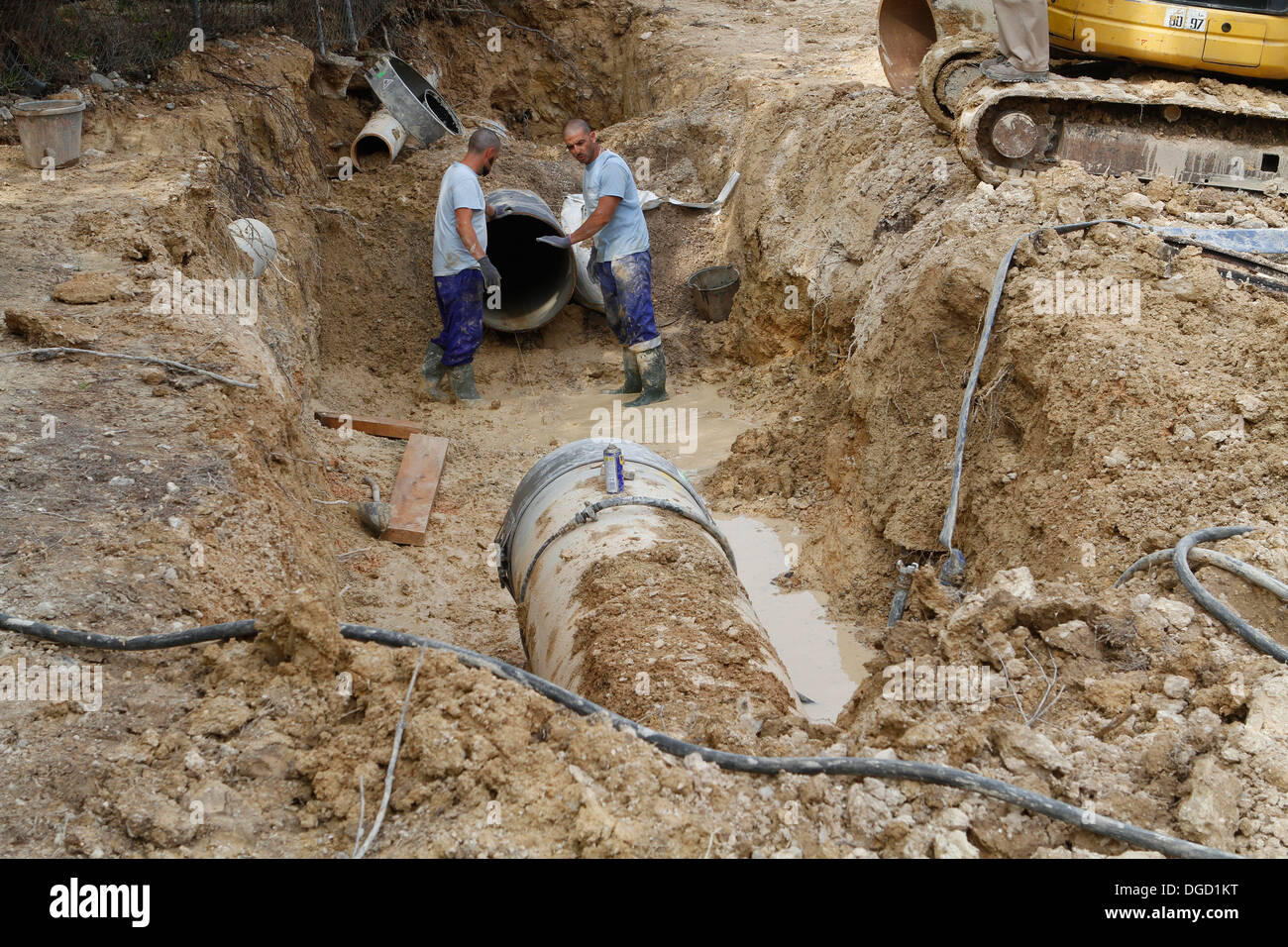 Workers on a broken water pipe outside of Palma de Mallorca Spain & Workers on a broken water pipe outside of Palma de Mallorca Spain ...