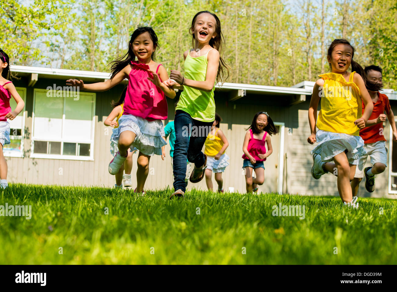 Children running on grass - Stock Image