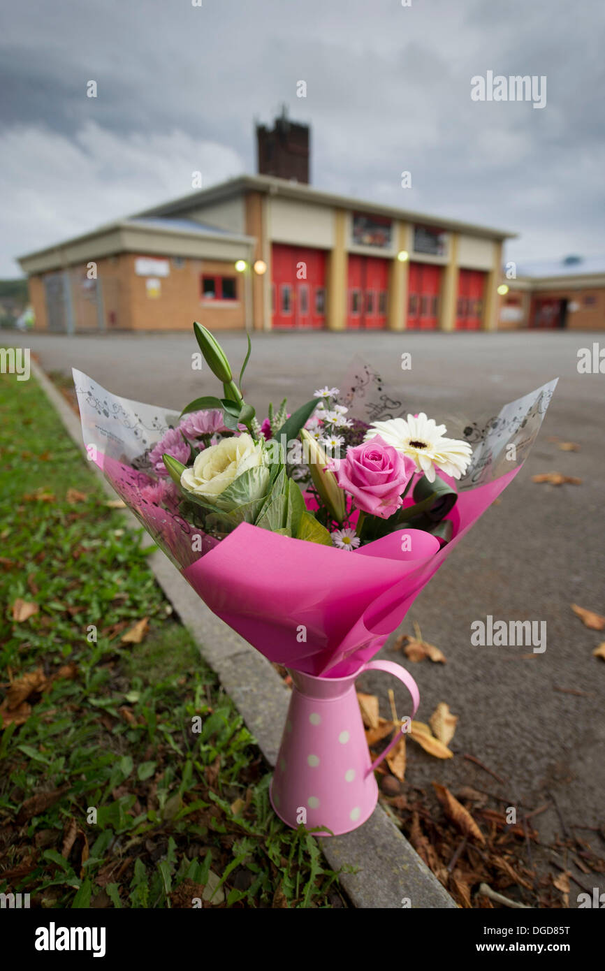 Cardiff, Wales, UK. 18th Oct, 2013. Floral tributes left outside the fire station where mum-of-three Karina Menzies was killed by Matthew Tvrdon who used a van in a series of hit and run attacks across Cardiff a year ago tomorrow on October 18, 2013 in Ely, Cardiff, Wales. Credit:  Matthew Horwood/Alamy Live News - Stock Image