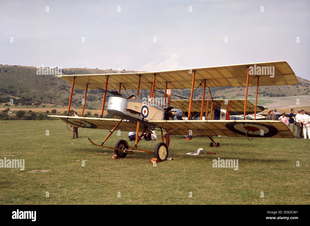 1970s, picture of a restored WW1 RAF fixed-wing biplane stationary outside on a grass field, England, Uk, showing Stock Photo