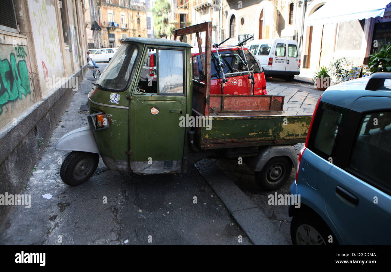 A parked van, Catania, Sicily, Italy. - Stock Image