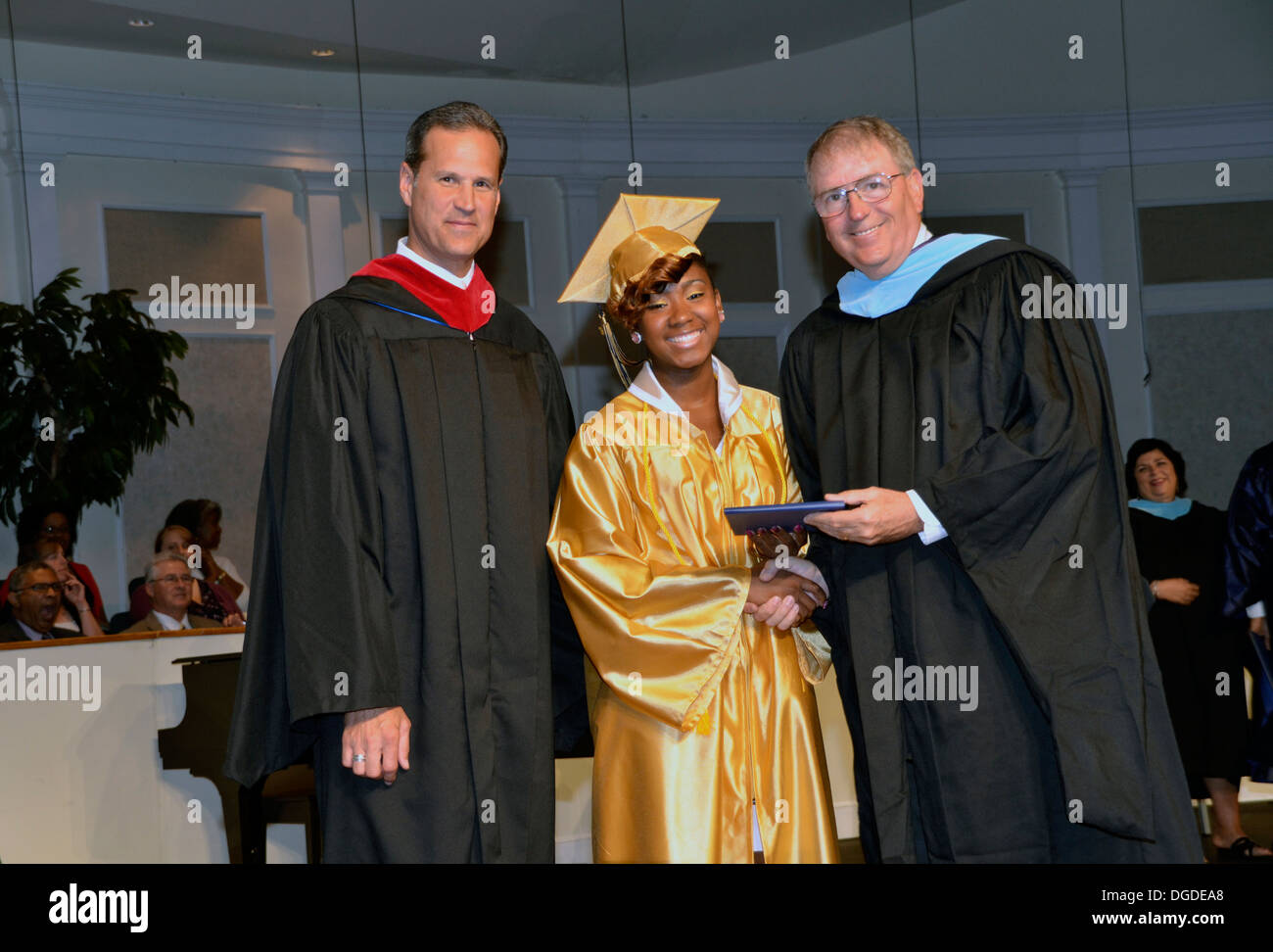 Teen receives a diploma in a high school graduation in Foresville, Maryland - Stock Image