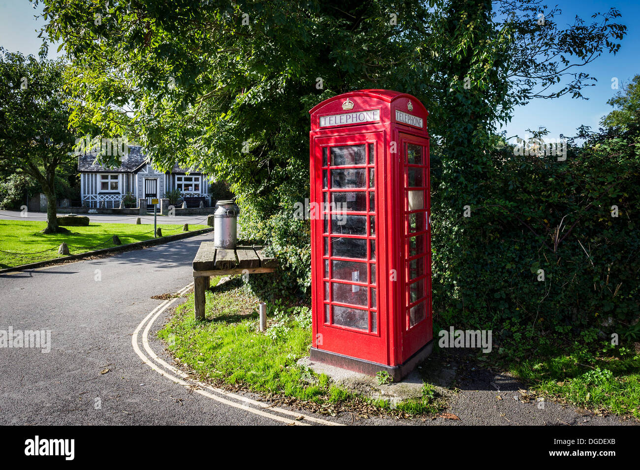 A traditional red telephone box on the village square in Crantock Village in Newquay Cornwall. - Stock Image