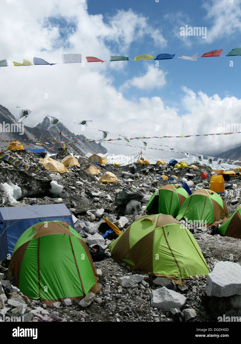 The colorful tents of Everest Base Camp dot the landscape at the foot of Mount Everest in Nepal. - Stock Image