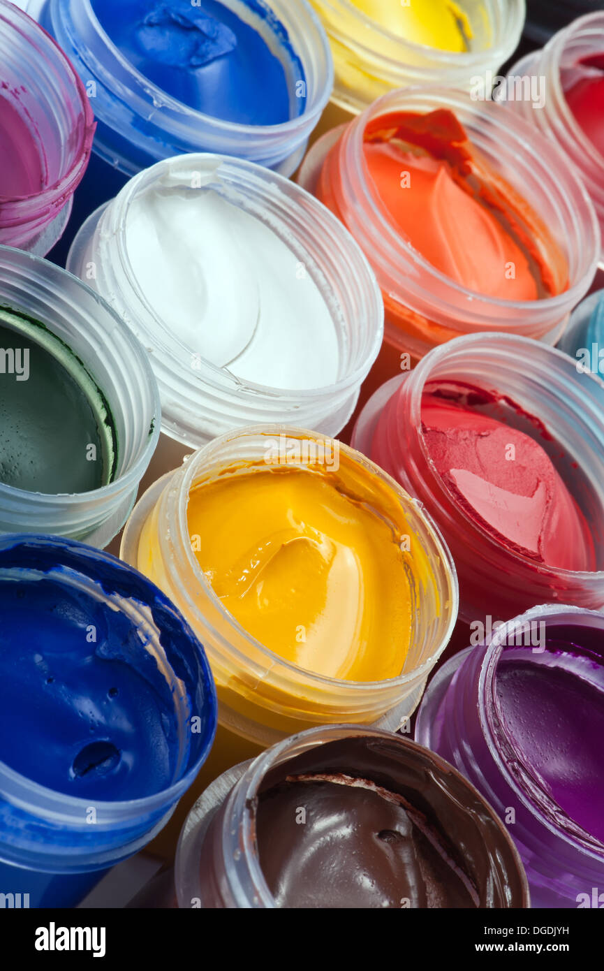 Closeup of opened jairs of gouache paints - Stock Image