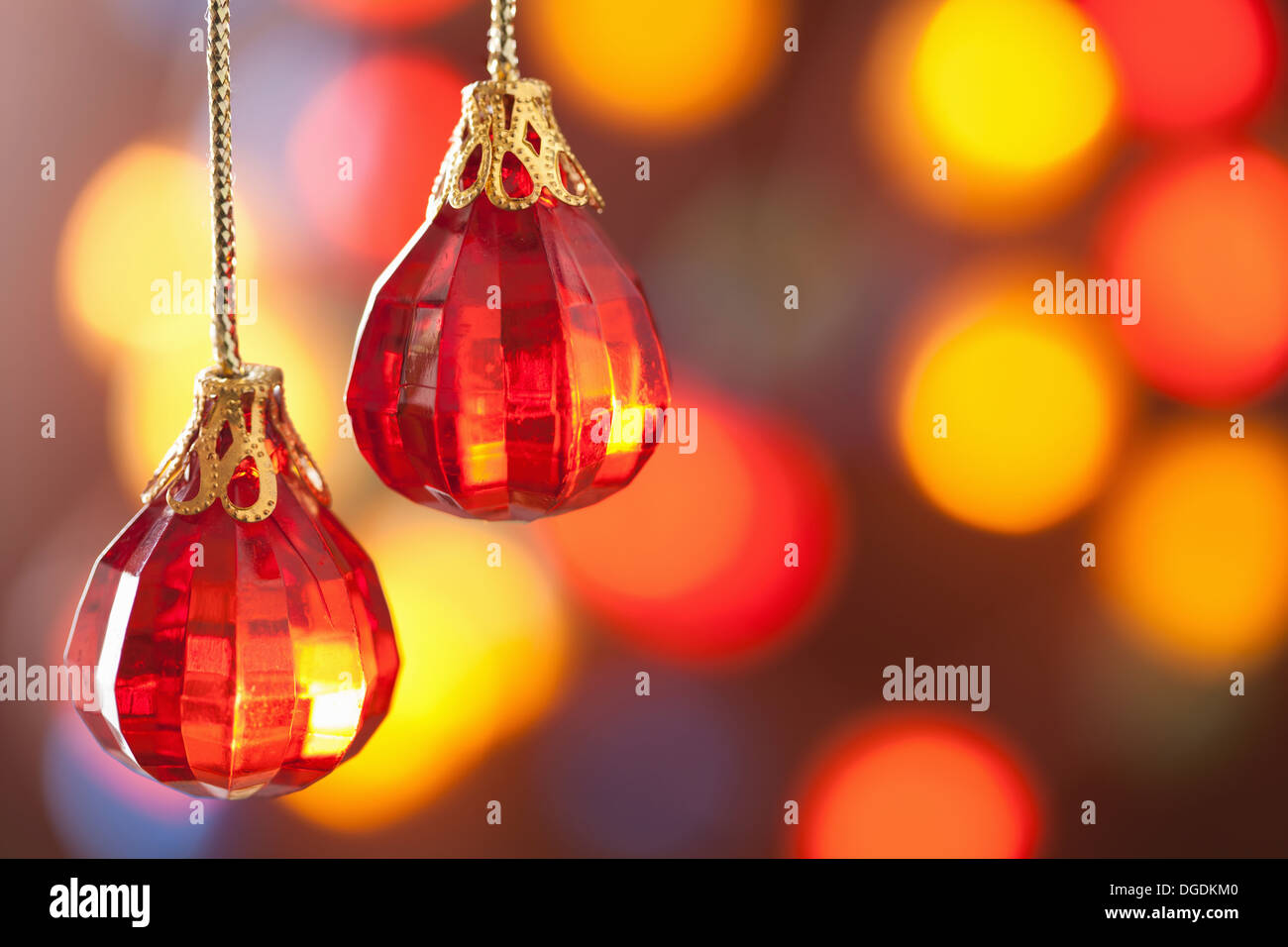 red Christmas decoration over blurred background - Stock Image