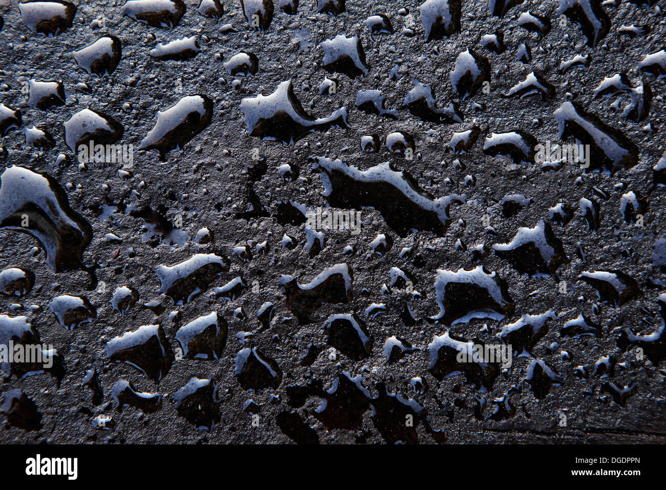Water drops on oily wooden surface of railway sleeper - Stock Image