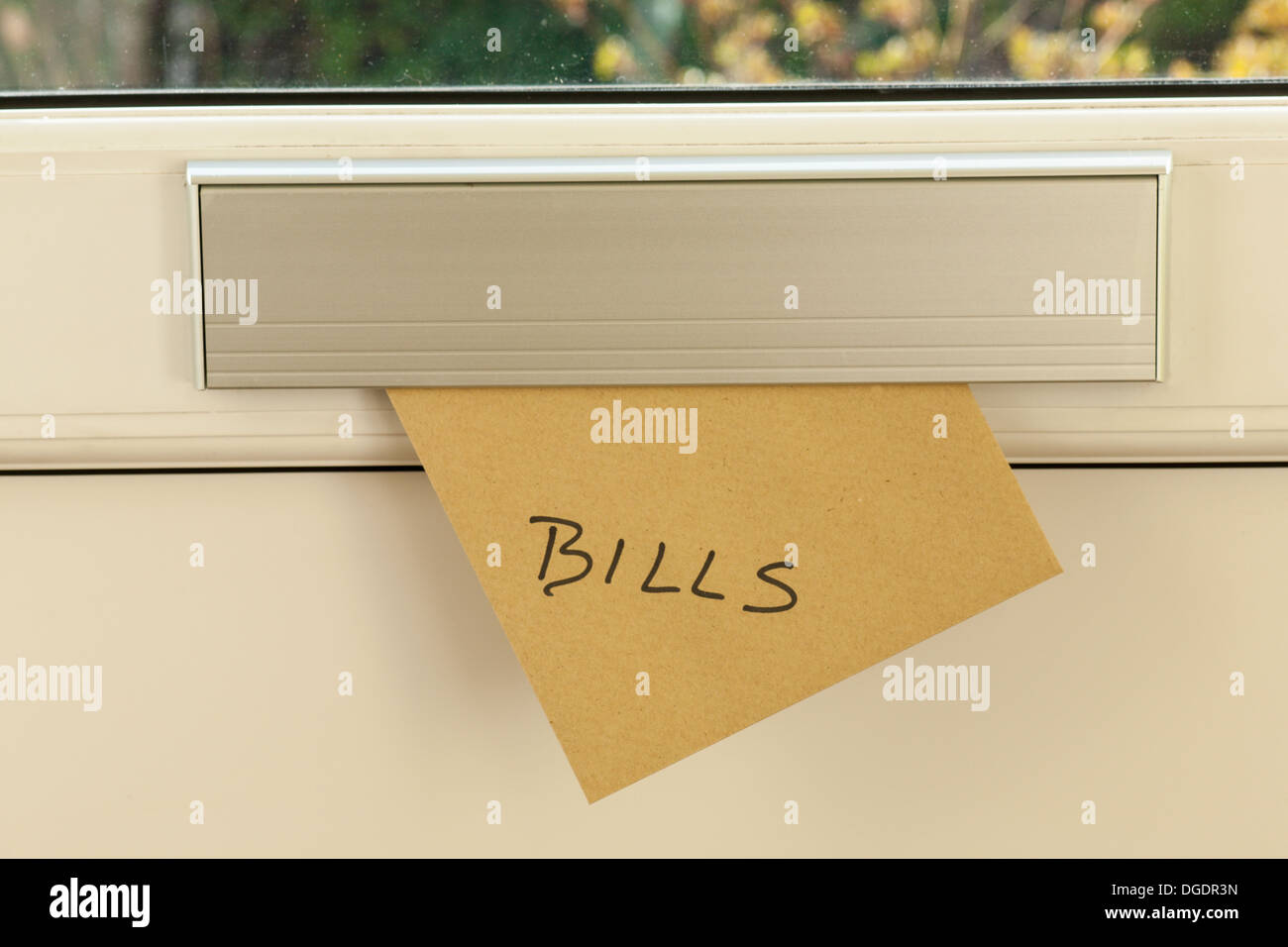 Bill posted through house letter box - Stock Image