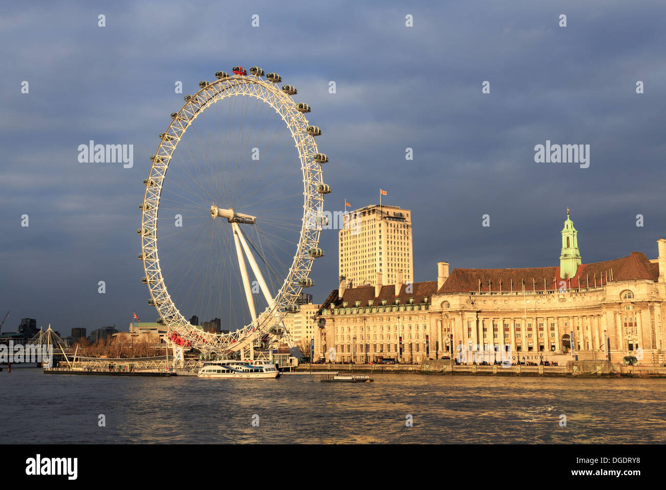 London Eye and County Hall in warm evening light - Stock Image