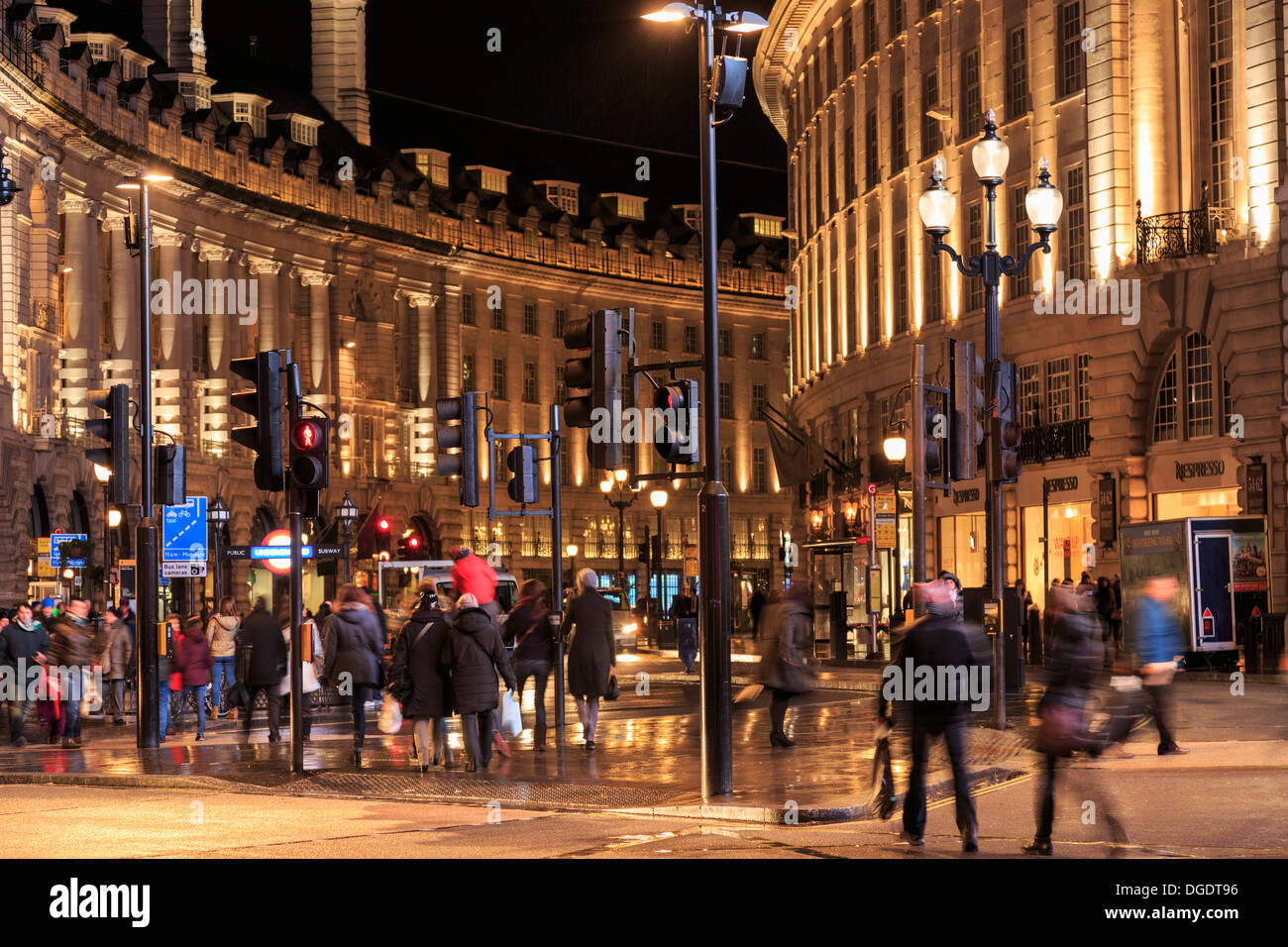 Shoppers and tourists Regent Street at night London - Stock Image