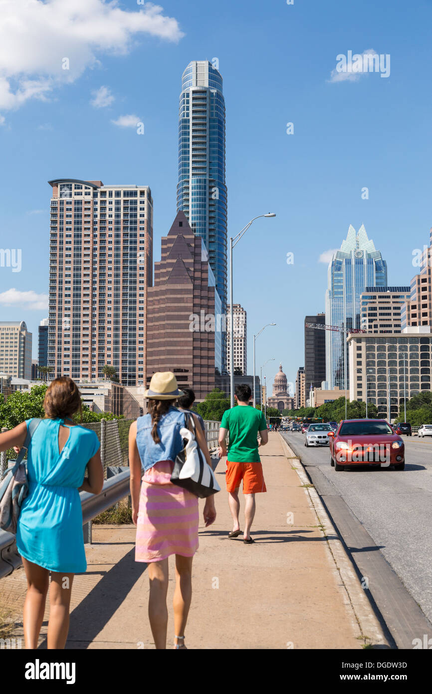 Traffic and tourists cross S Congress Avenue bridge with Austin skyline in background Texas USA - Stock Image