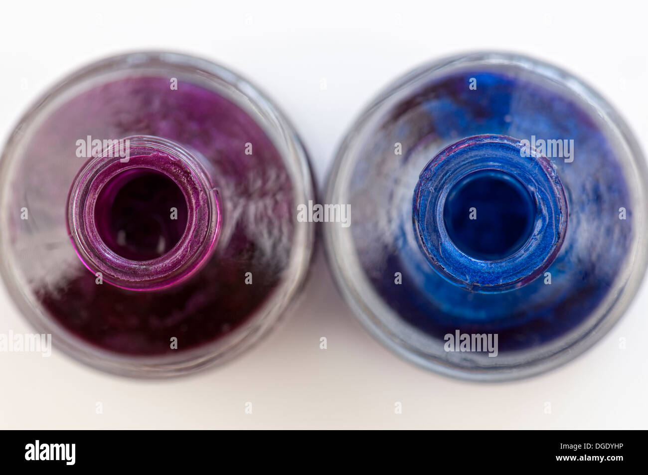 Close up of nail varnish pots in purple and blue - Stock Image