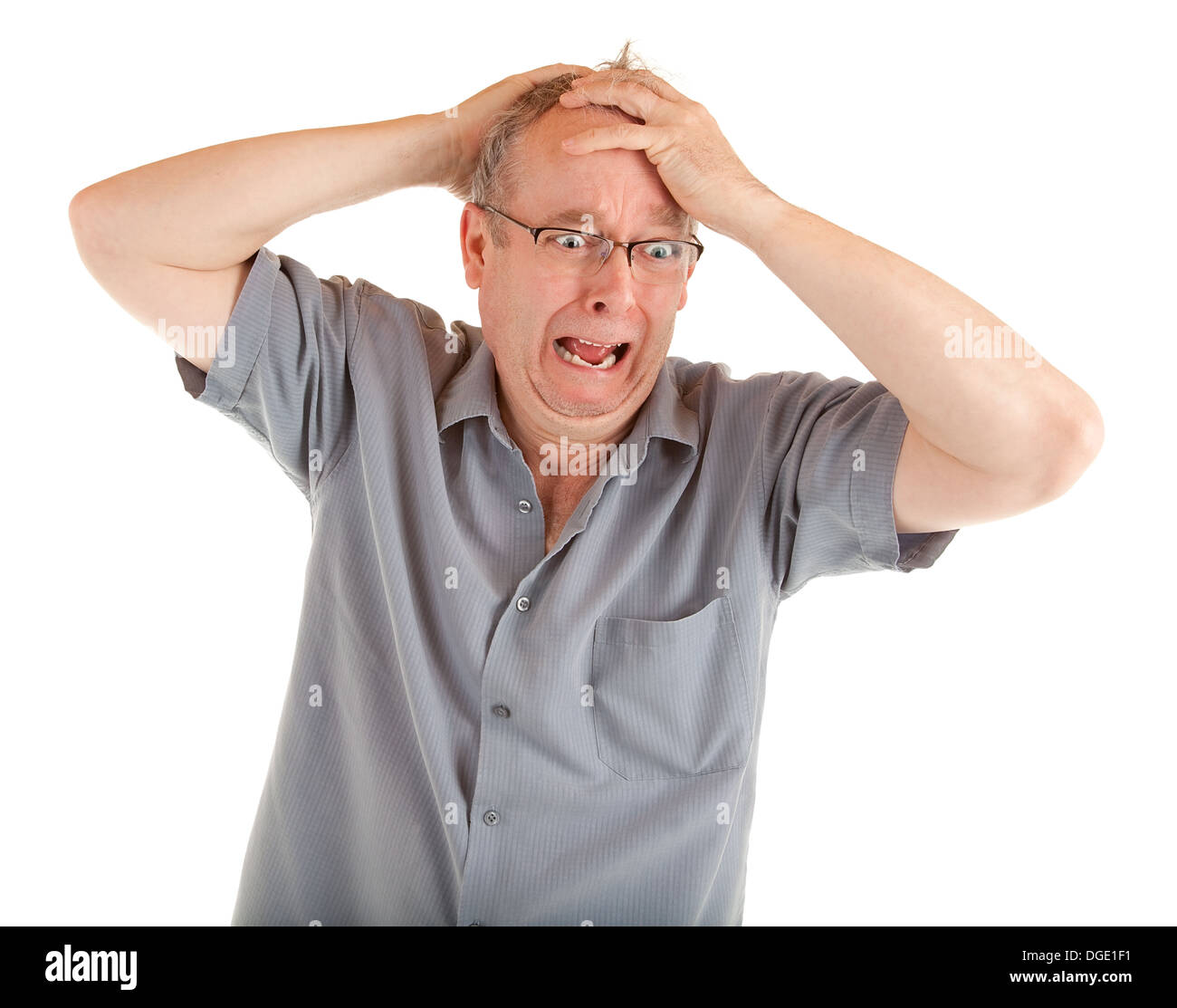 man holding his head in disbelief and shocked just got very bad news