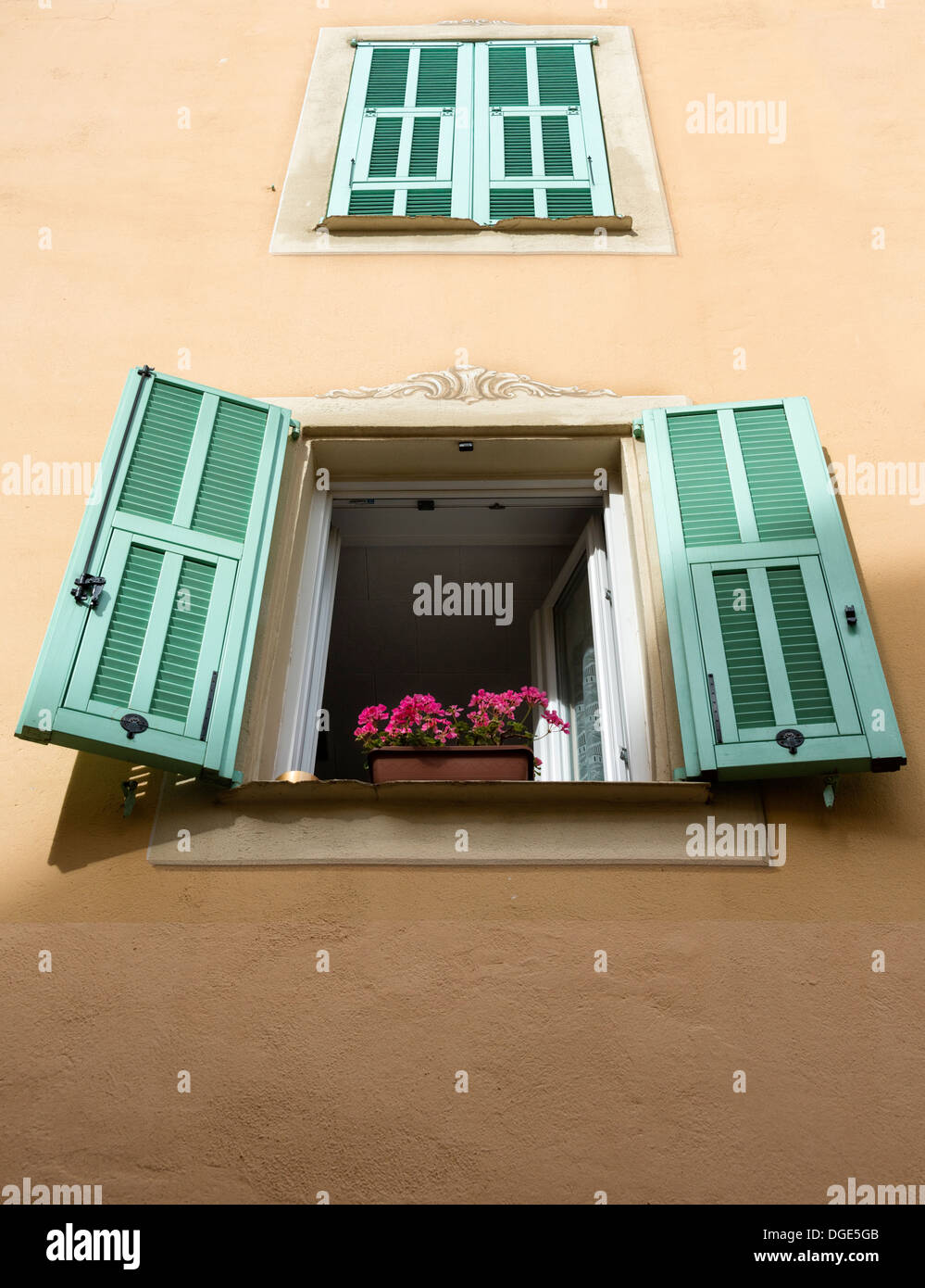 Shuttered windows in Place St Nicolas in Monaco - Stock Image