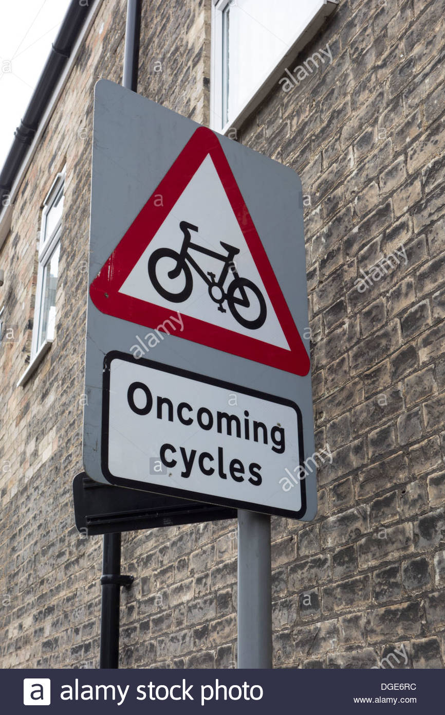Warning sign - oncoming cycles - Stock Image