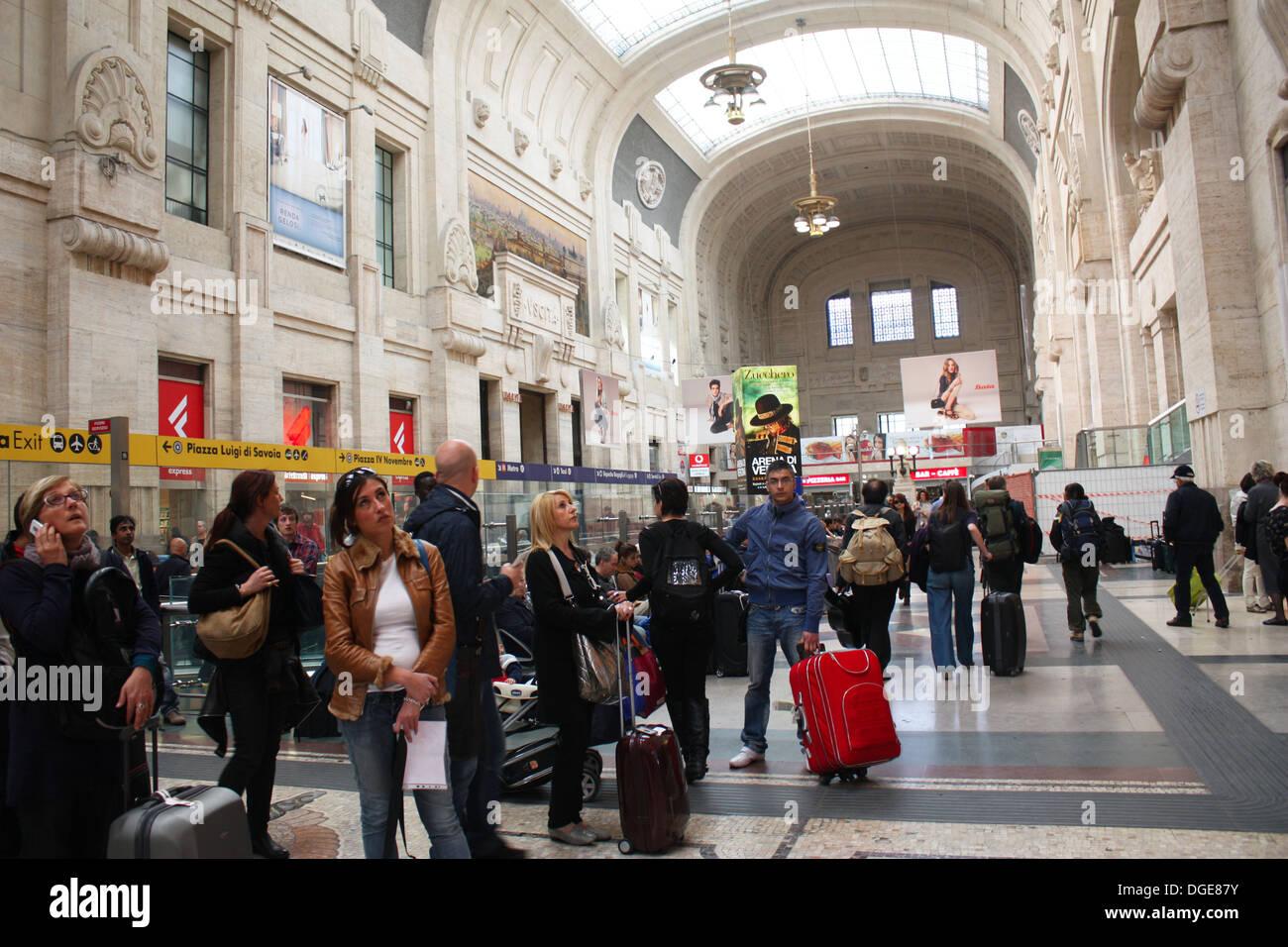 People waiting in Milan railway station Stock Photo