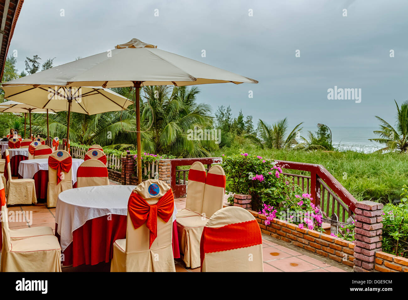 Table setting at an outdoor restaurant at the Thanh Tam Seaside Resort near Hue, Vietnam, Asia. - Stock Image