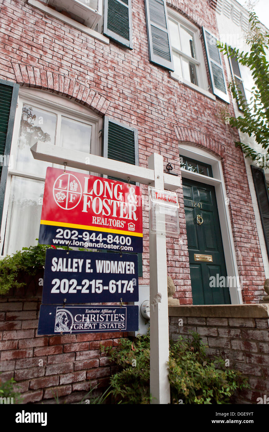 Realtor sign in front of townhouse - Washington, DC USA - Stock Image