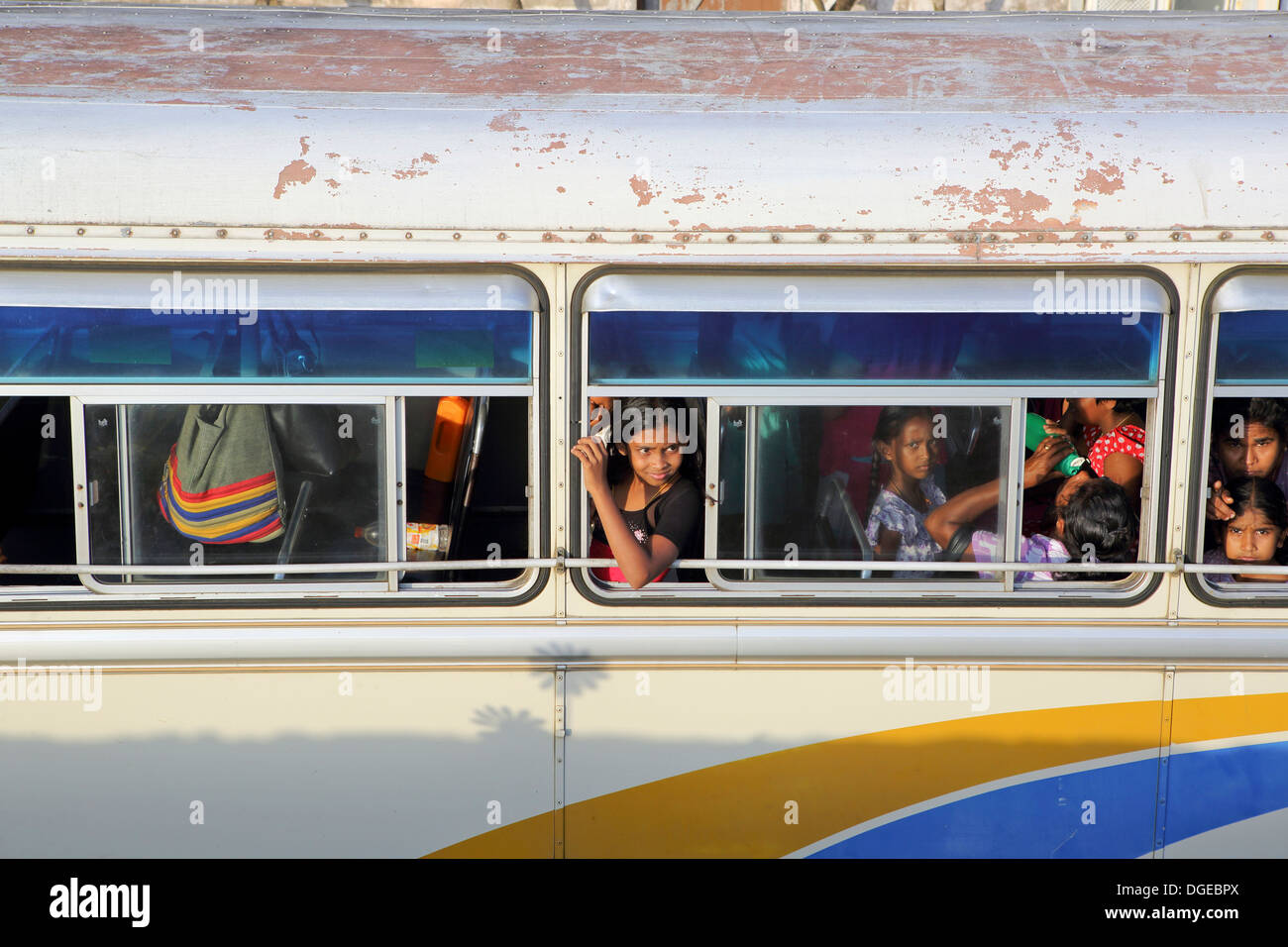 Children looking out window of bus - Stock Image