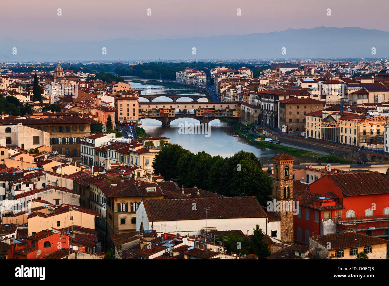 italy tuscany florence city panoramic view over downtown arno river and bridges ponte Vecchio red roofs of old town at sunrise p - Stock Image