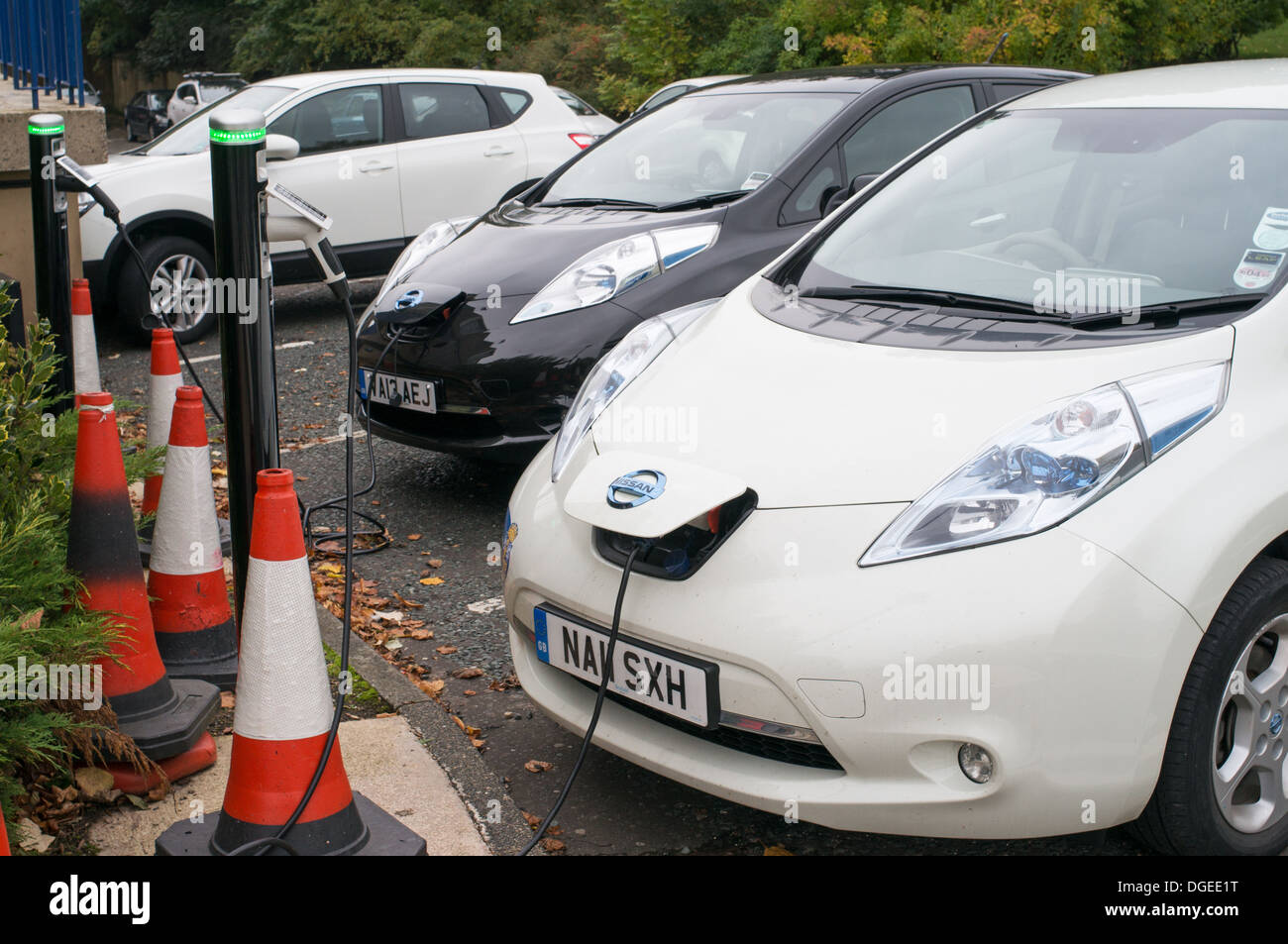 Two Nissan Leaf Electric Cars Being Charged Durham North East Stock