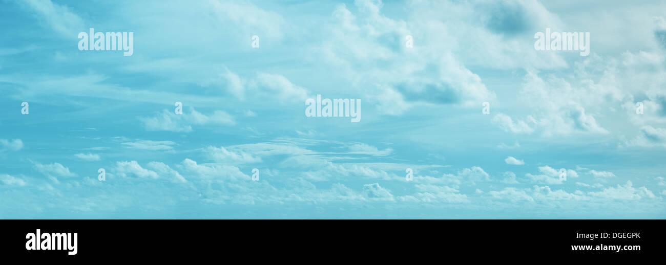 Panoramic skyscape with different clouds - natural background - Stock Image