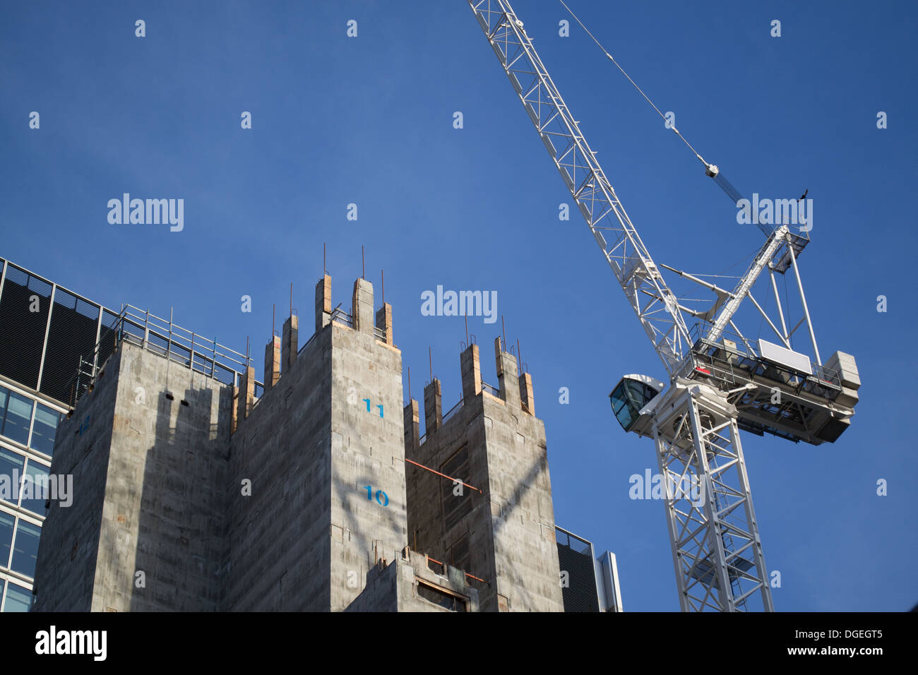 Moorgate Exchange construction showing a luffing crane and the concrete core - Stock Image