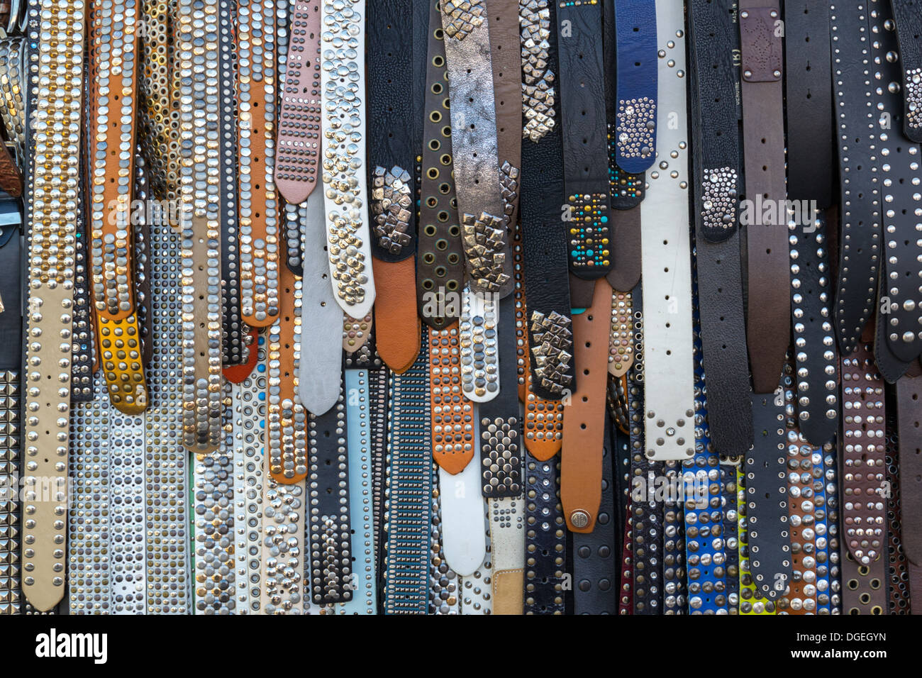 Leather belts hung up for sale - Stock Image