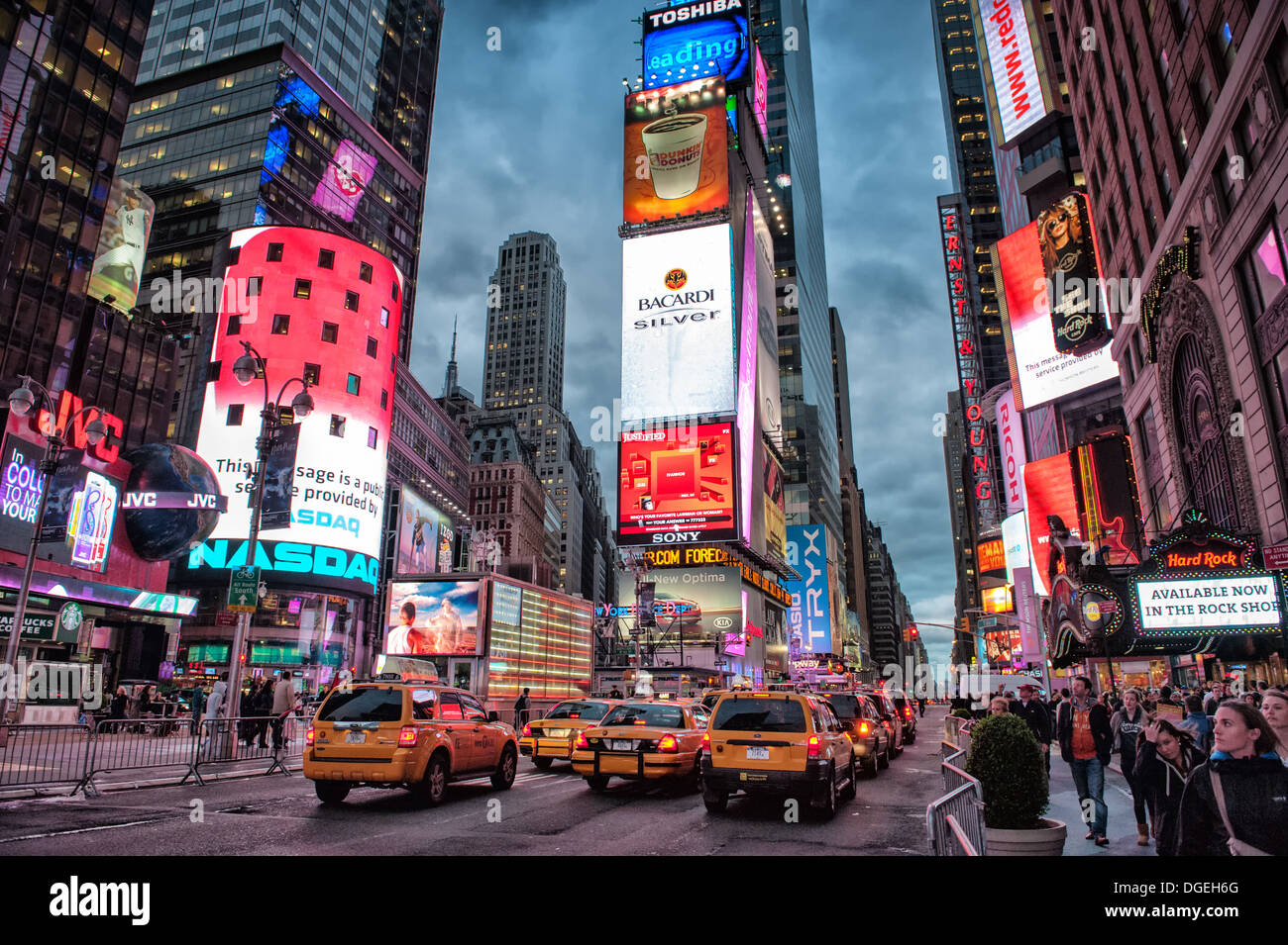 Lively Times Square by night in New York City, NY, USA - Stock Image