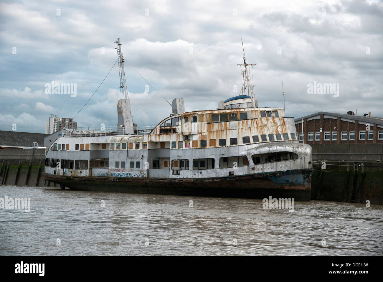 The rusting hulk of the old Mersey Ferry The Royal Iris tied up on the banks of the River Thames in Woolwich, East London. - Stock Image