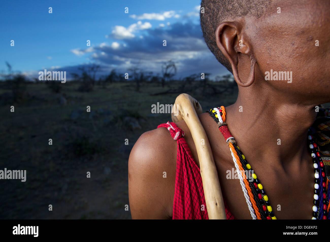 Close up of Maasai man's stretched earlobe, Mara region, Kenya - Stock Image