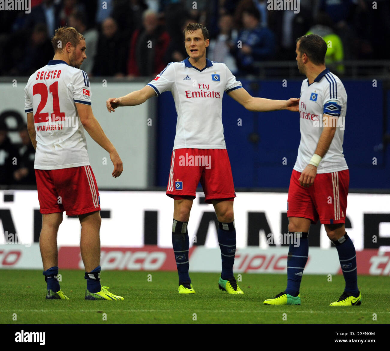 Hamburg, Germany. 20th Oct, 2013. Hamburg's Maximilian Beister (L-R), Marcell Jansen and Rafael van der Vaart chat during the German Bundesliga soccer match between Hamburger SV and VfB Stuttgart at the Imtech Arena in Hamburg, Germany, 20 October 2013. Photo: ANGELIKA WARMUTH (ATTENTION: Due to the accreditation guidelines, the DFL only permits the publication and utilisation of up to 15 pictures per match on the internet and in online media during the match.)/dpa/Alamy Live News - Stock Image