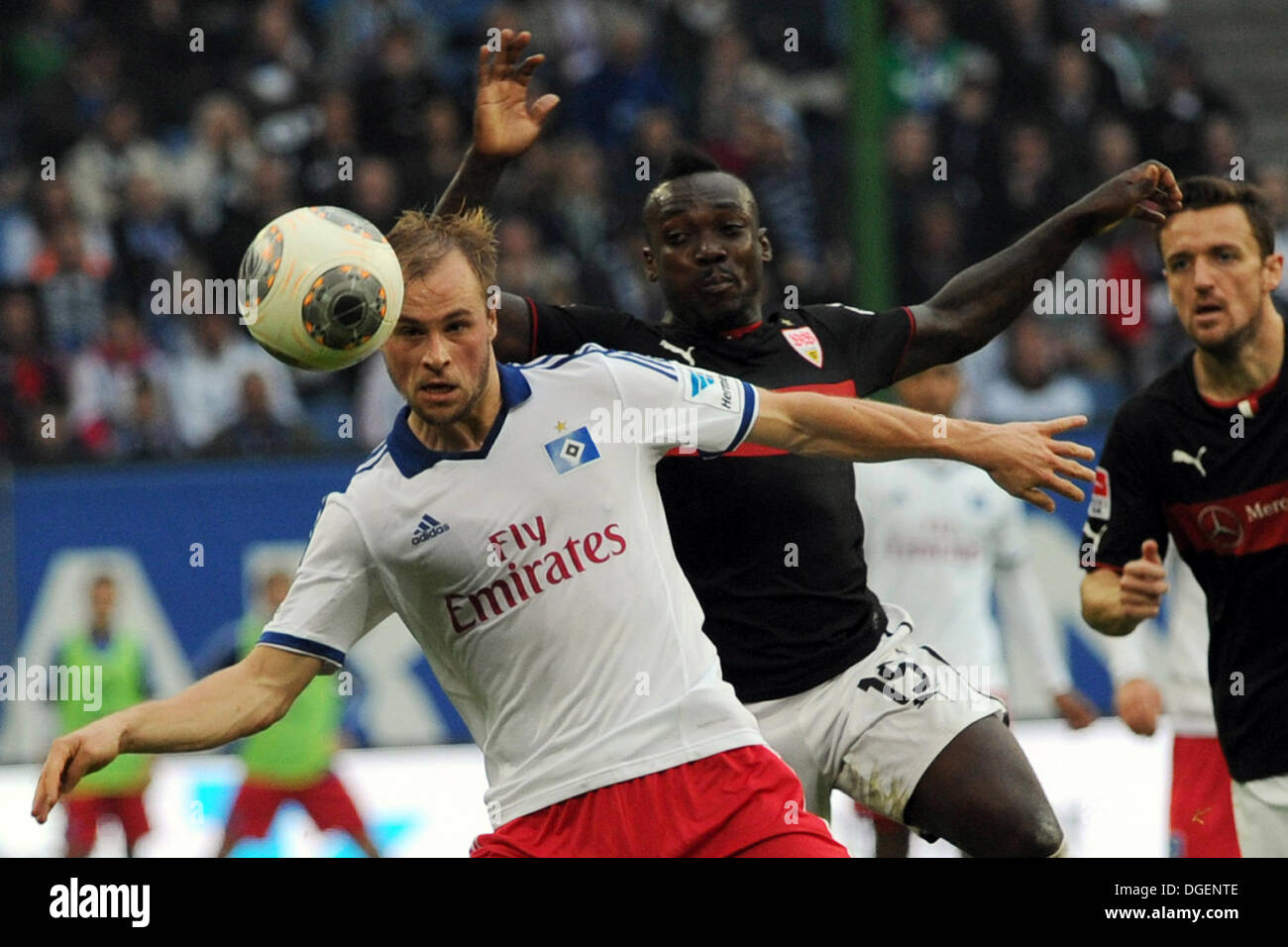 Hamburg, Germany. 20th Oct, 2013. Hamburg's Maximilian Beister (L) vies for the ball with Stuttgart's Arthur Boka (C) next to Stuttgart's Christian Gentner during the German Bundesliga soccer match between Hamburger SV and VfB Stuttgart at the Imtech Arena in Hamburg, Germany, 20 October 2013. Photo: ANGELIKA WARMUTH (ATTENTION: Due to the accreditation guidelines, the DFL only permits the publication and utilisation of up to 15 pictures per match on the internet and in online media during the match.)/dpa/Alamy Live News - Stock Image