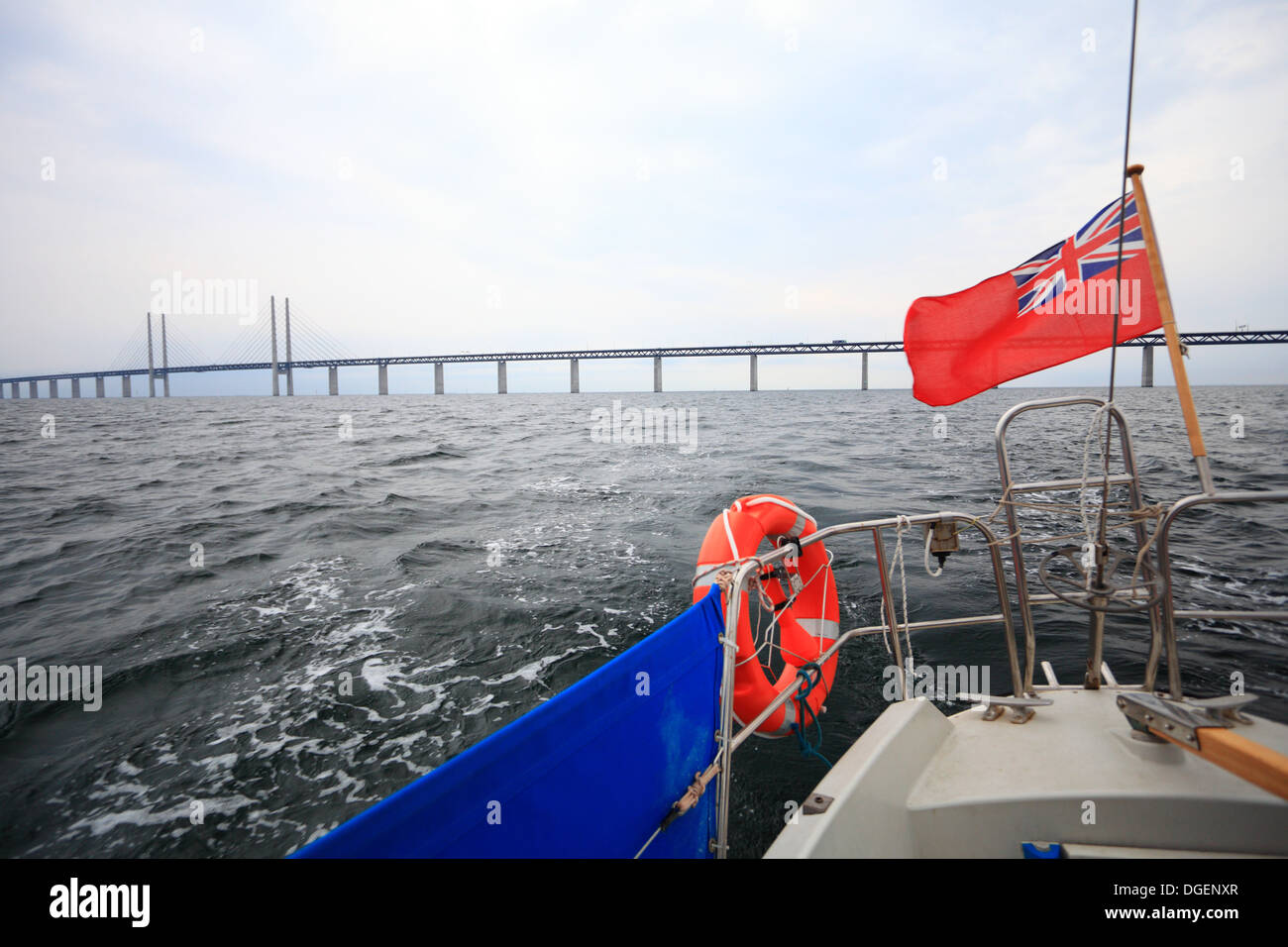 Landmark danish oresund bridge- view from sailboat with british flag. Cruise and tourism. Stock Photo