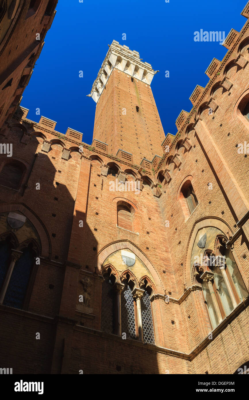 Piazza del Campo is the main square of Siena with view on Palazzo Pubblico and its Torre del Mangia. - Stock Image