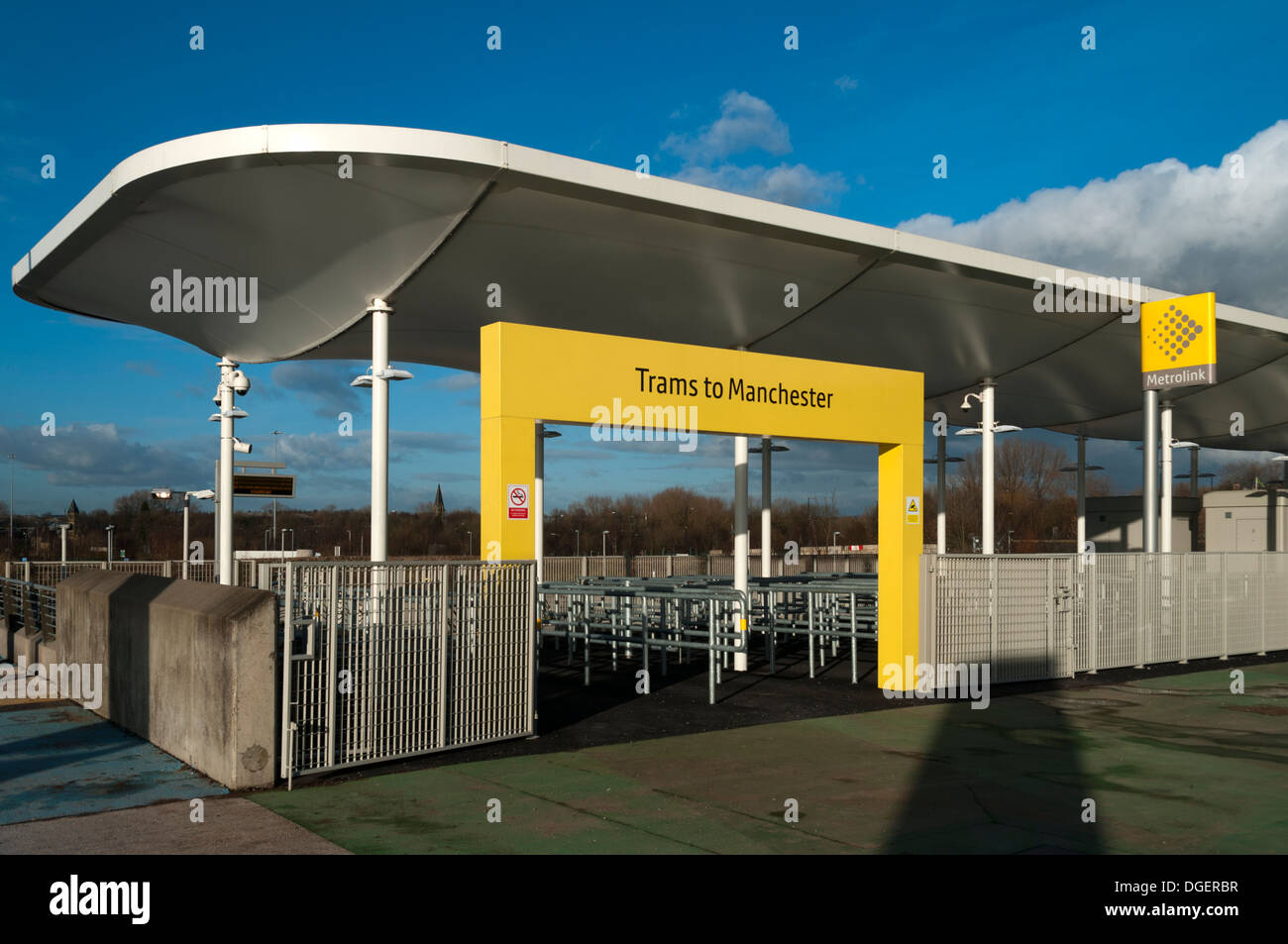 Match day turnstile exit of the Metrolink tram stop at the Etihad Campus, Eastlands, Manchester, England, UK - Stock Image