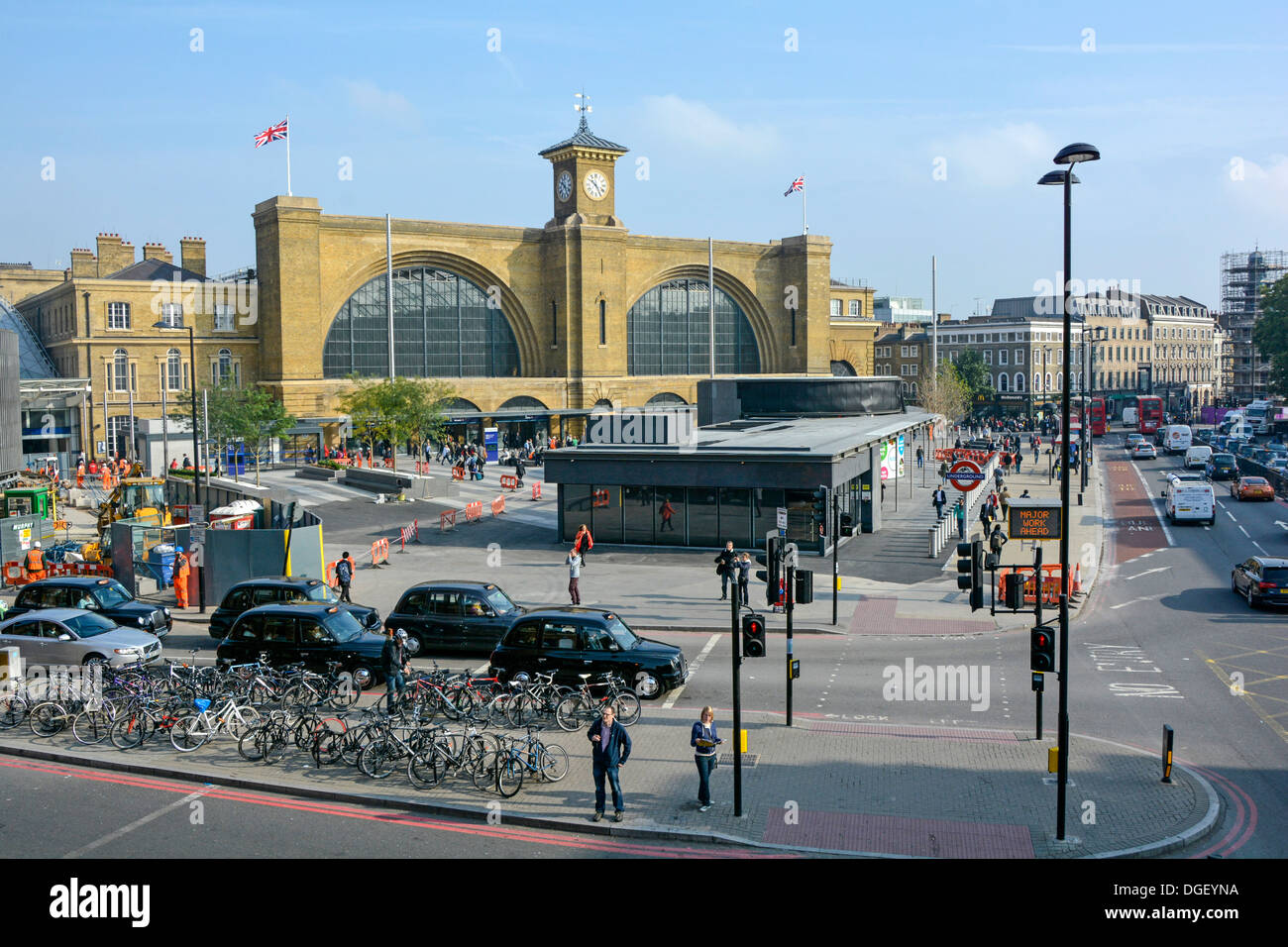Remodeled Kings Cross Square and railway station facade part of the regeneration of King's Cross station - Stock Image