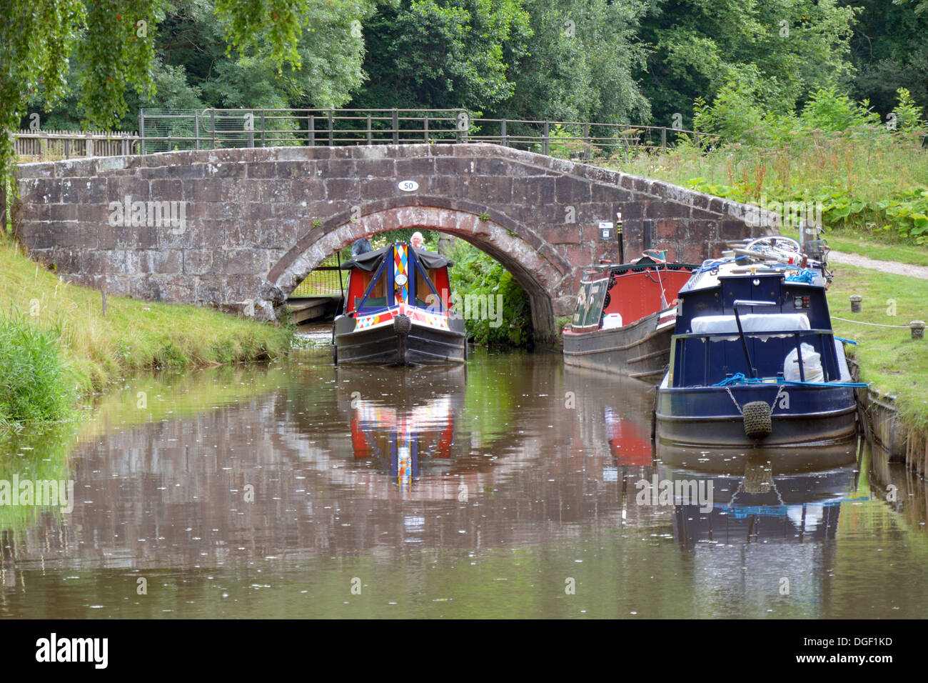 Narrowboat passing under the bridge at Consall - Caldon Canal, Staffordshire - Stock Image