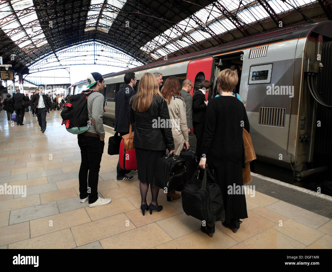 Commuters boarding a train at Bristol Temple Meads Railway Station England UK KATHY DEWITT Stock Photo