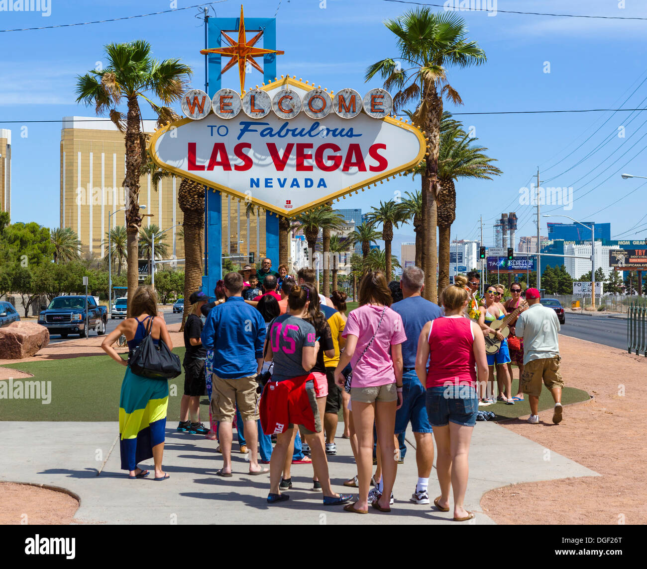 Tourists lining up to have a photo taken under the Welcome to Fabulous Las Vegas sign, Las Vegas, Nevada, USA - Stock Image