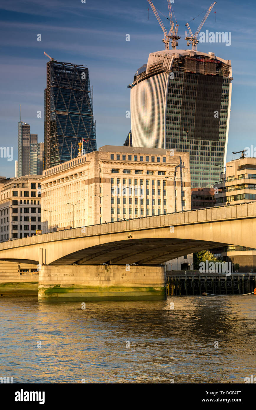 Walkie Talkie, Cheesegrater, Heron Tower from under London Bridge - Stock Image