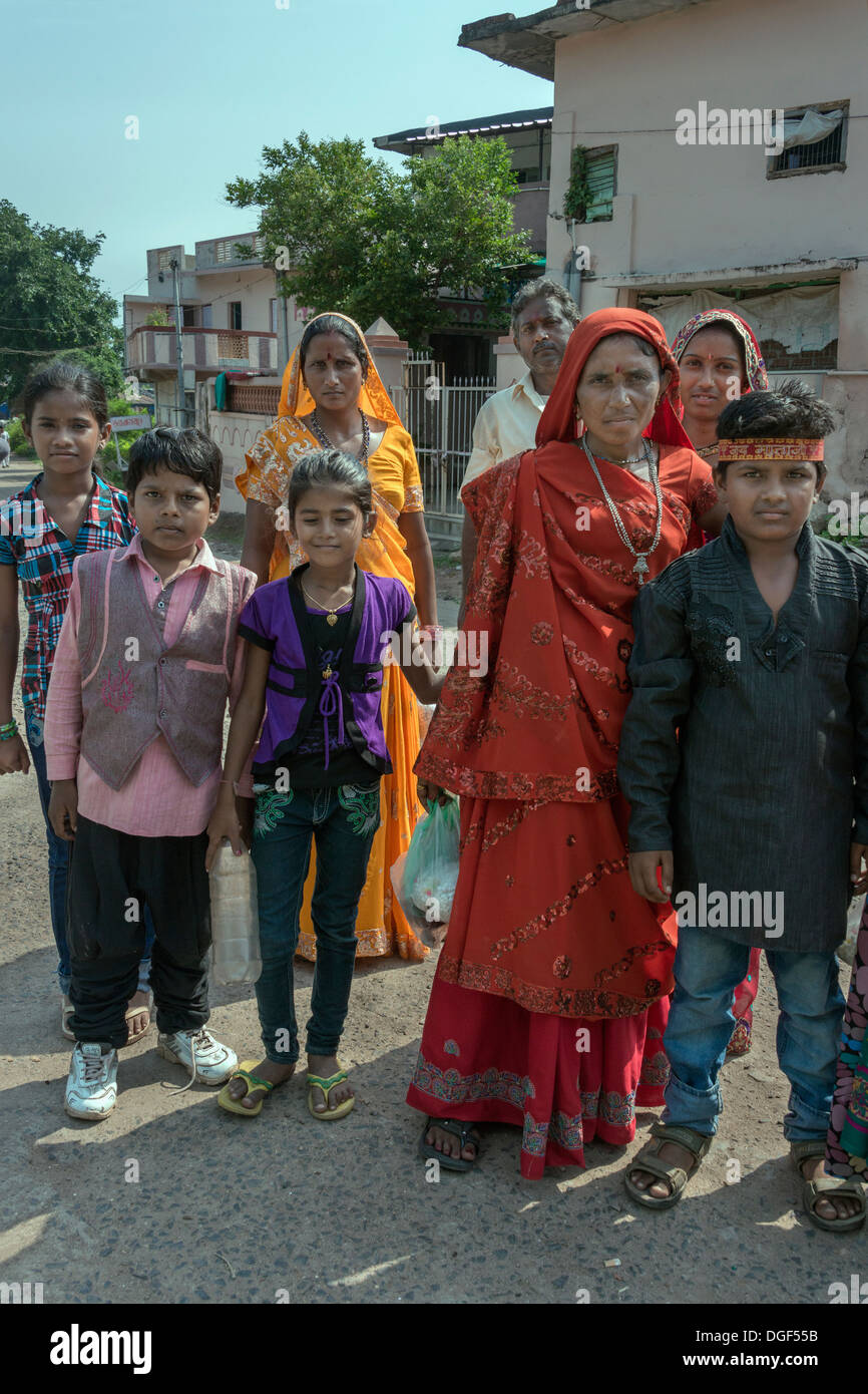 Younger and older generations with their different dress styles, near the Sahar Ki Masjid mosque, Champaner, Gujurat, India - Stock Image