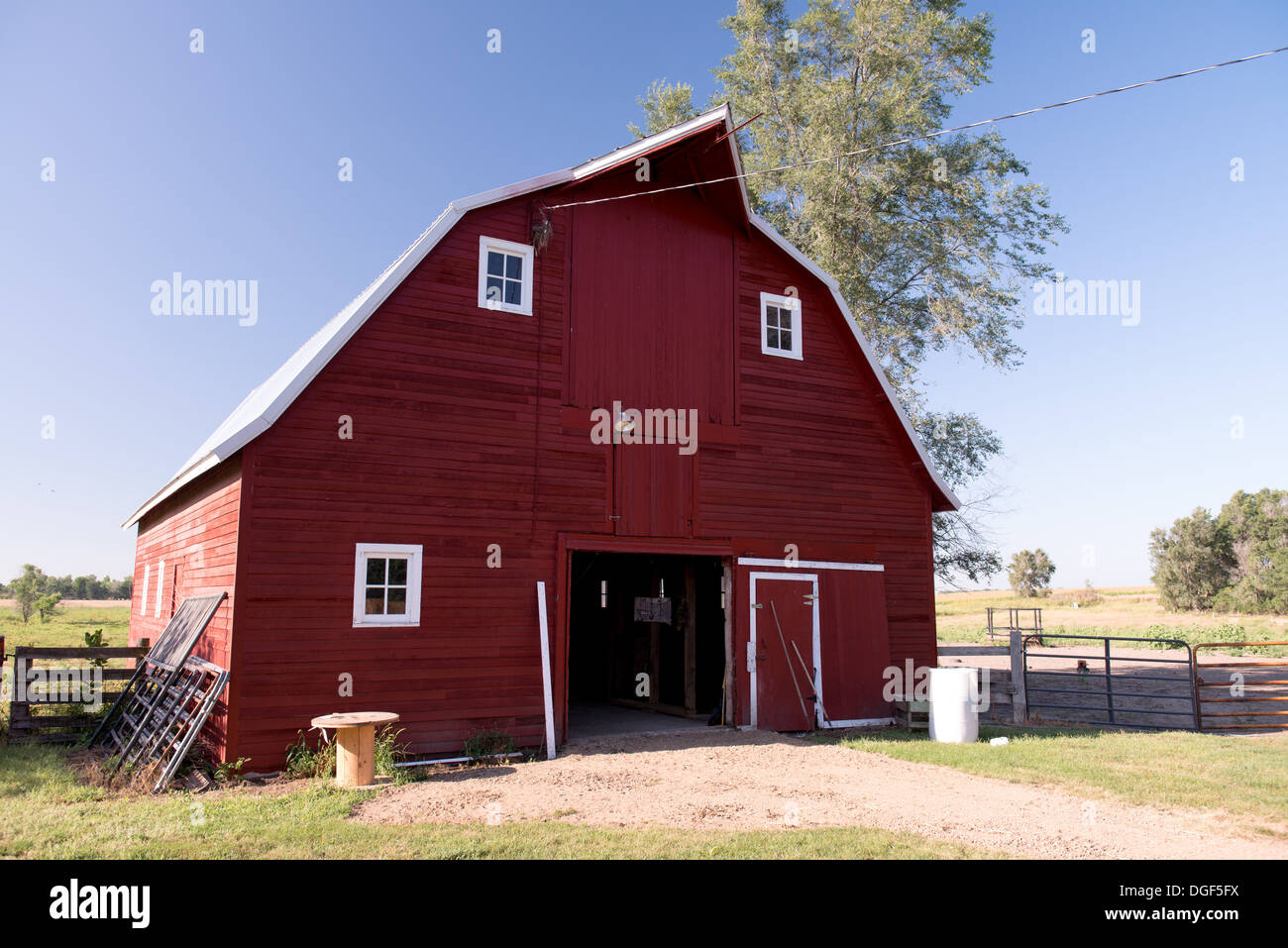 Red Barn with White Windows - Stock Image