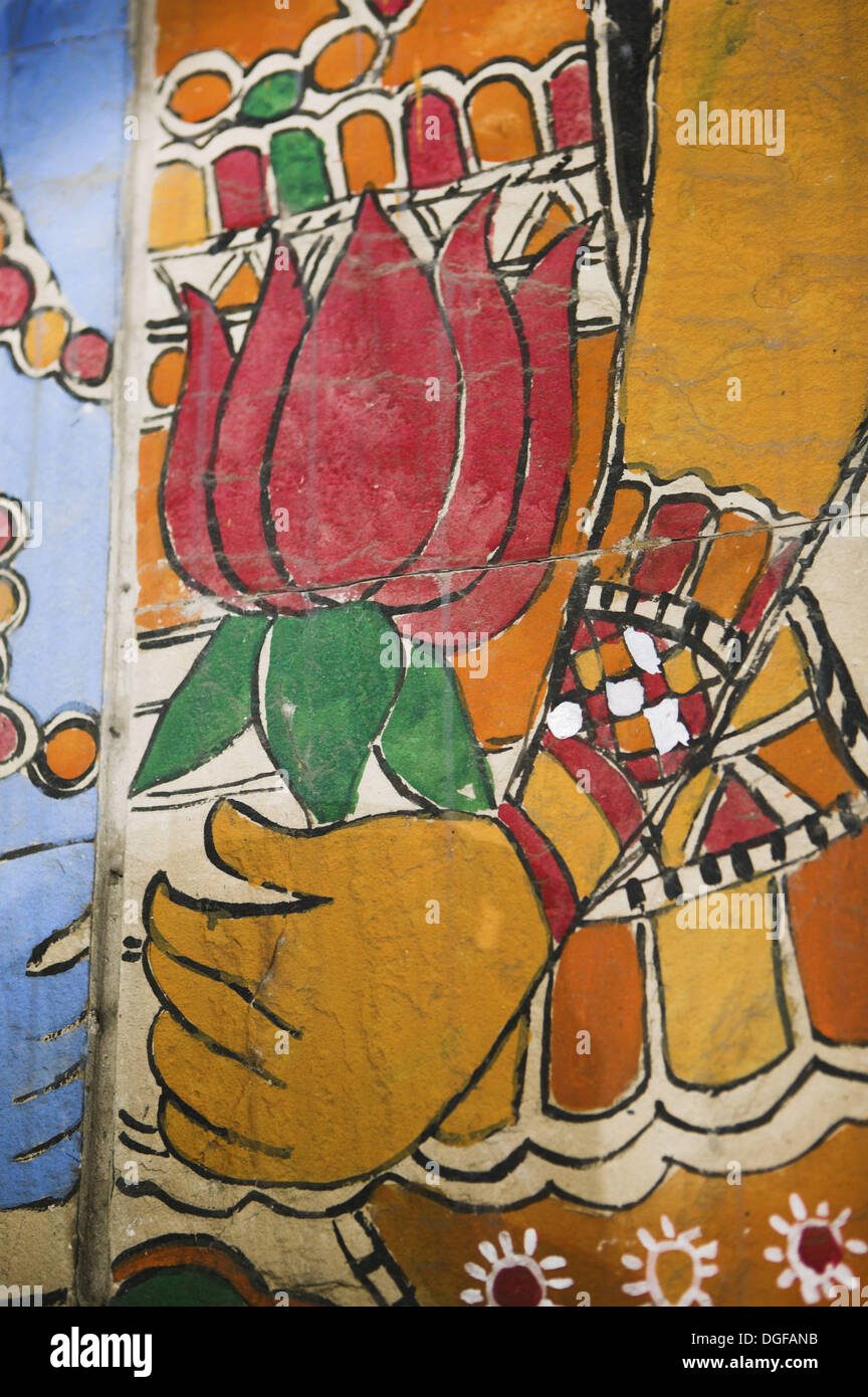 Indian painting of hand holding lotus flower. New Delhi. India. - Stock Image