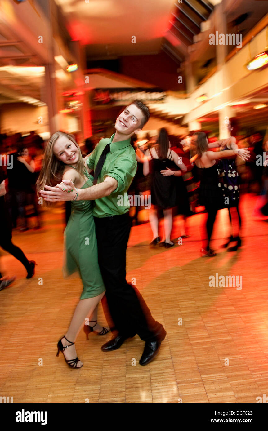 Young couple dancing at the prom of a dance school, Germany - Stock Image
