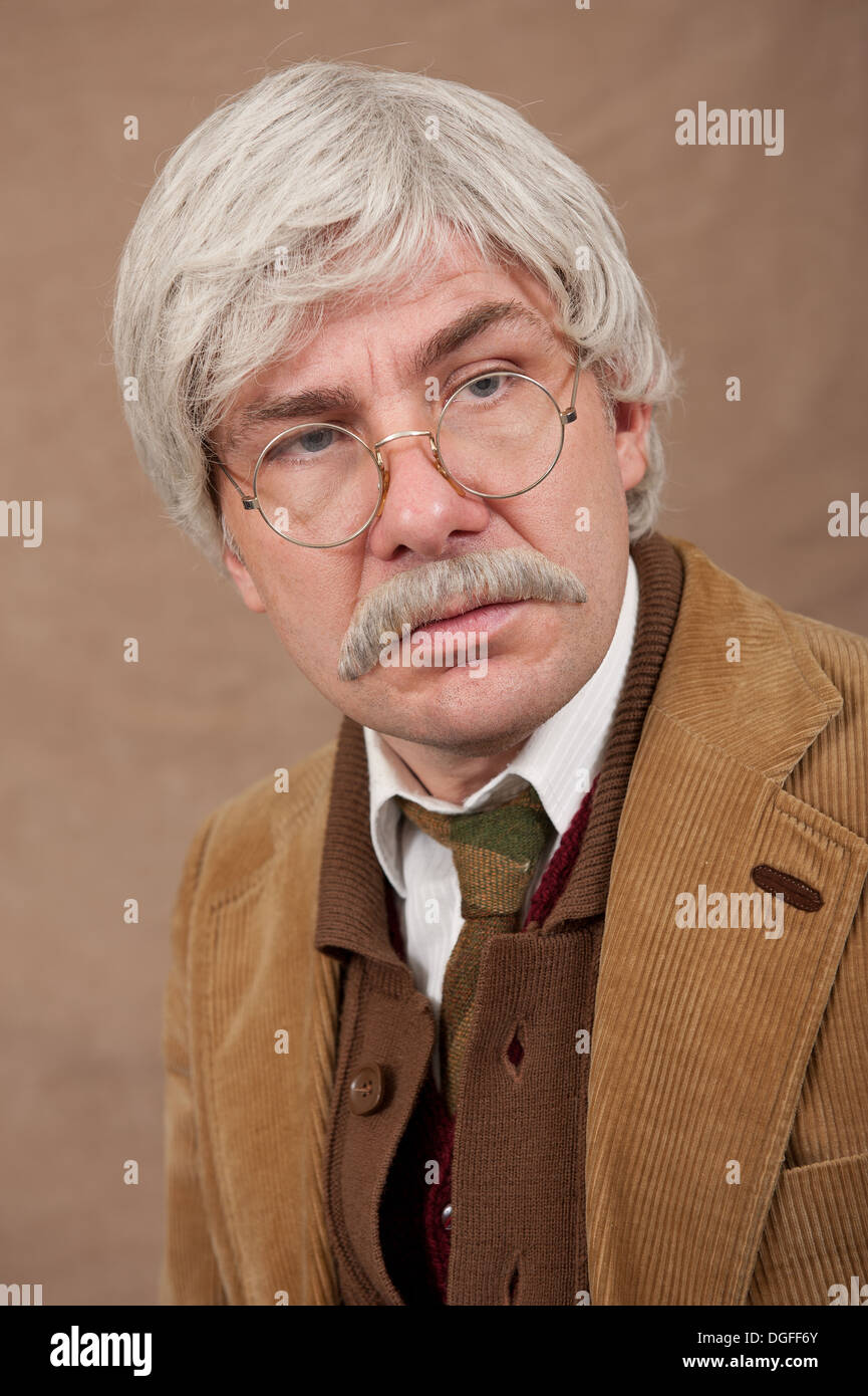 Portrait of a serious looking grey haired old man wearing comfy clothes. - Stock Image