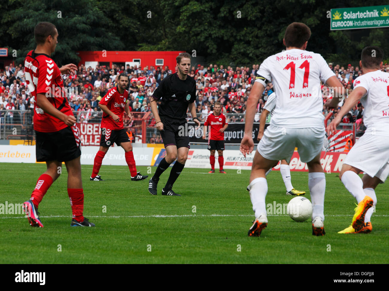 sports, football, Regional League West, 2013/2014, Rot Weiss Oberhausen versus Rot Weiss Essen 2:0, Stadium Niederrhein in Oberhausen, scene of the match, referee Martin Thomsen in the thick of the action - Stock Image