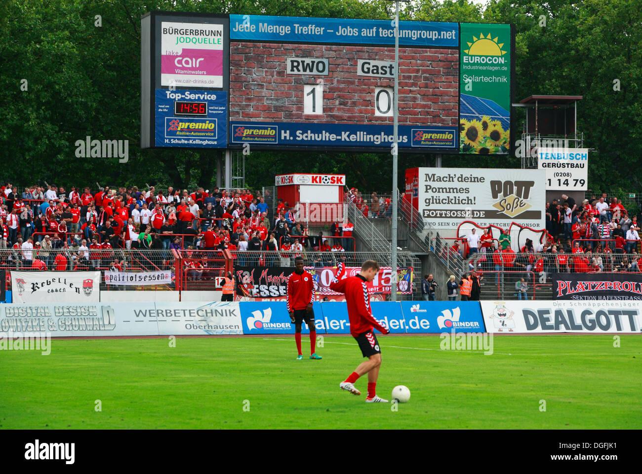 sports, football, Regional League West, 2013/2014, Rot Weiss Oberhausen versus Rot Weiss Essen 2:0, Stadium Niederrhein in Oberhausen, half-time break, score board, scoreline 1:0, stand-by players - Stock Image
