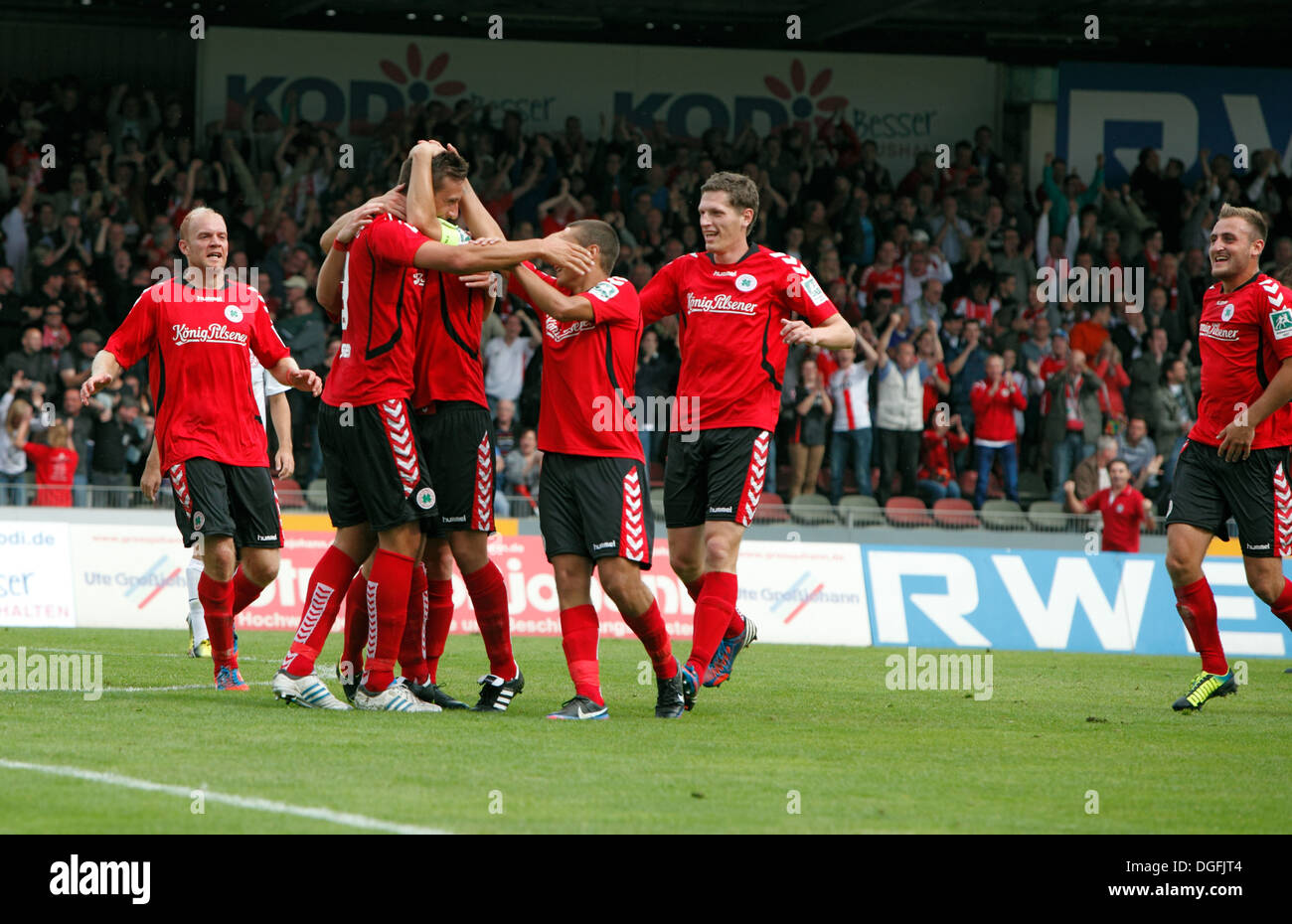 sports, football, Regional League West, 2013/2014, Rot Weiss Oberhausen versus Rot Weiss Essen 2:0, Stadium Niederrhein in Oberhausen, scene of the match, RWO goal celebration after the 2:0 goal by Daniel Jansen - Stock Image