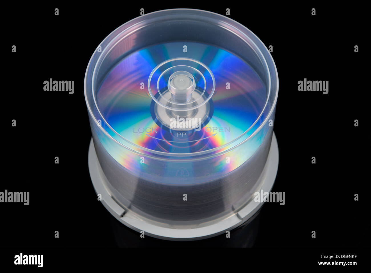 stack of dvd's, cd's on a spindle - Stock Image